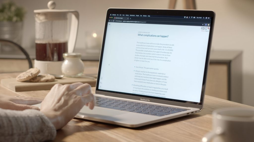 Somebody using a laptop that is displaying a consent document