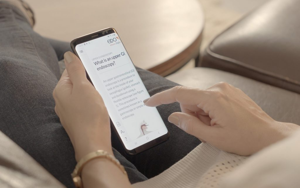 Somebody using a mobile phone that is displaying a medical document